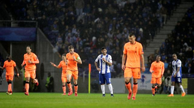 Soccer Football - Champions League Round of 16 First Leg - FC Porto vs Liverpool - Estadio do Dragao, Porto, Portugal - February 14, 2018 Porto's Jesus Corona looks dejected as Liverpool's Roberto Firmino celebrates scoring their fourth goal REUTERS/Miguel Vidal