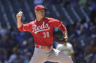 Cincinnati Reds starting pitcher Tyler Mahle throws to the Milwaukee Brewers during the first inning of a baseball game Wednesday, June 16, 2021, in Milwaukee. (AP Photo/Jeffrey Phelps)