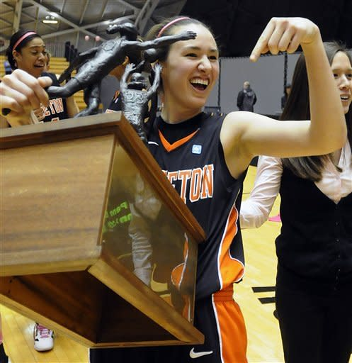 Princeton's Lauren Edwards celebrates with the Ivy League Conference championship trophy after defeating Dartmouth 94-57 in an NCAA college basketball game, Saturday, Feb. 25, 2012, in Princeton, N.J. Edwards scored a career-high 29 points. (AP Photo/MJ Schear)