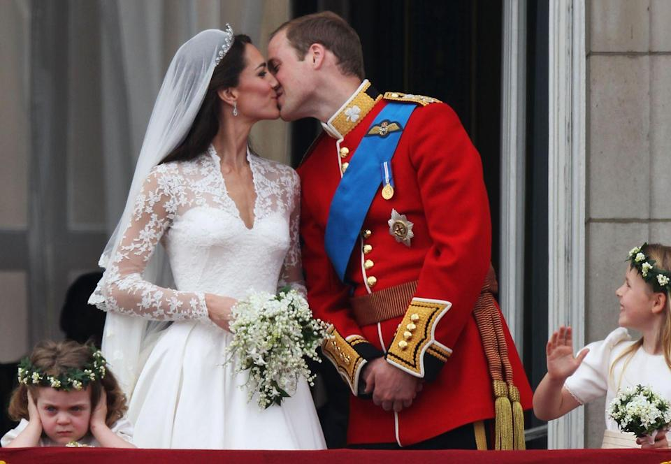 "<p>Just after <a href=""https://www.townandcountrymag.com/the-scene/weddings/g20052313/kate-middleton-prince-william-royal-wedding-2011-photos/"" rel=""nofollow noopener"" target=""_blank"" data-ylk=""slk:their royal wedding"" class=""link rapid-noclick-resp"">their royal wedding</a>, Kate and Will kiss for the crowd. <br></p>"