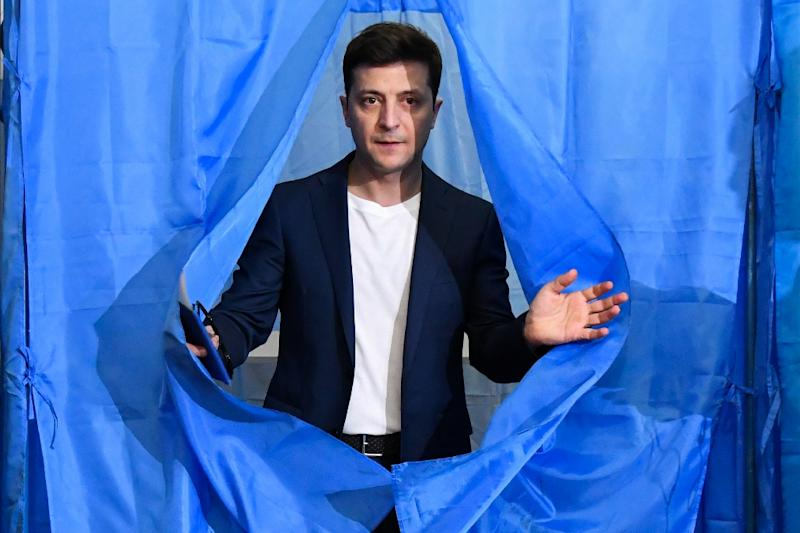 Ukrainian comedian and presidential candidate Volodymyr Zelensky, at a voting booth, is expected to win, according to polls