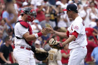 St. Louis Cardinals relief pitcher Giovanny Gallegos and catcher Andrew Knizner celebrate an 8-7 victory over the San Diego Padres in a baseball game Sunday, Sept. 19, 2021, in St. Louis. (AP Photo/Jeff Roberson)