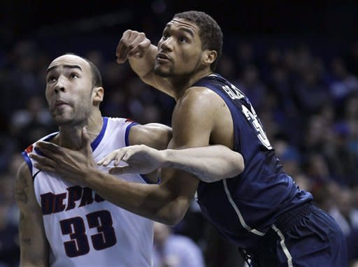 DePaul center Krys Faber (33) and Pittsburgh center Malcolm Gilbert, battle for a rebound during the first half of a Big East NCAA college basketball game on Thursday, Jan. 5, 2012, in Rosemont, Ill. (AP Photo/Charles Rex Arbogast)