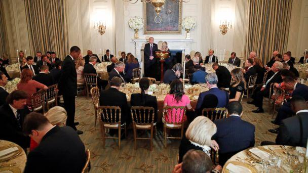 PHOTO: President Donald Trump bows his head in prayer as pastor Paula White leads the room in prayer during a dinner for evangelical leaders in the State Dining Room of the White House, Monday, Aug. 27, 2018, in Washington. (AP)