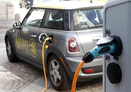 A BMW Mini electric car is charged at a station downtown Munich