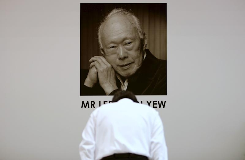 A man bows as he pays his respects to late former prime minister Lee Kuan Yew at Tanjong Pagar community club, in the constituency which Lee represented as Member of Parliament since 1955, in Singapore March 23, 2015. Lee, Singapore's first prime minister, died on Monday aged 91, triggering a flood of tributes to the man who oversaw the tiny city-state's rapid rise from a British colonial backwater to a global trade and financial centre. REUTERS/Edgar Su