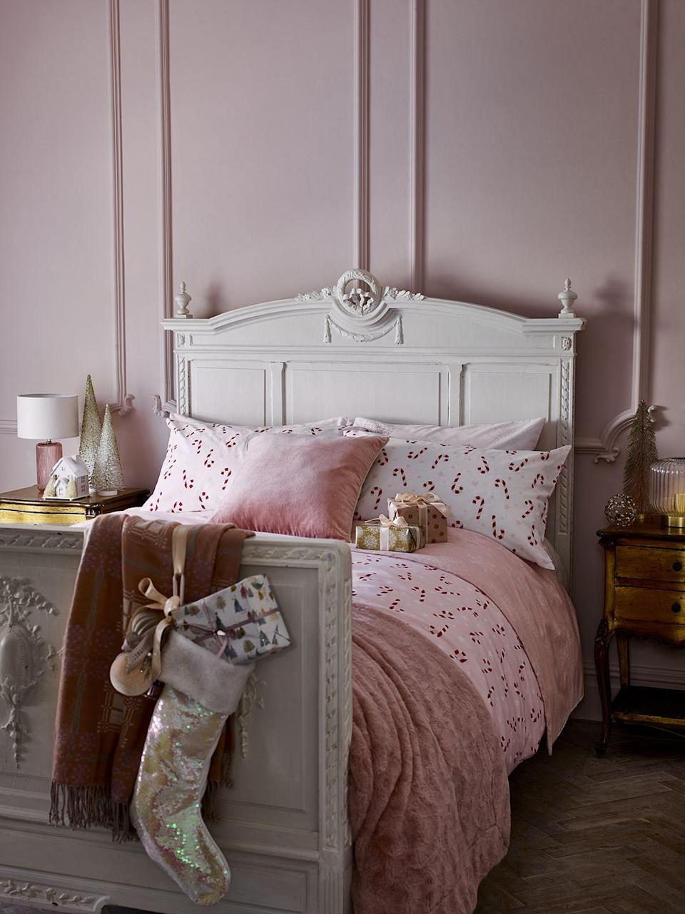 """<p>Searching for Christmas <a href=""""https://www.housebeautiful.com/uk/decorate/bedroom/g37103497/pink-grey-bedroom/"""" rel=""""nofollow noopener"""" target=""""_blank"""" data-ylk=""""slk:bedroom"""" class=""""link rapid-noclick-resp"""">bedroom</a> decor? Look no further than George Home's new collection, which has everything from candy cane duvet covers to tinsel polar bears to place on your bedside table. From subtle additions to all-out festive schemes, add some holiday cheer to your <a href=""""https://www.housebeautiful.com/uk/lifestyle/a36981564/reclaim-sleep/"""" rel=""""nofollow noopener"""" target=""""_blank"""" data-ylk=""""slk:sleep"""" class=""""link rapid-noclick-resp"""">sleep</a> space. </p><p><strong>READ MORE</strong>: <a href=""""https://www.housebeautiful.com/uk/decorate/bedroom/a34973955/christmas-bedroom-decor/"""" rel=""""nofollow noopener"""" target=""""_blank"""" data-ylk=""""slk:8 easy ways to make your bedroom feel festive"""" class=""""link rapid-noclick-resp"""">8 easy ways to make your bedroom feel festive</a></p>"""