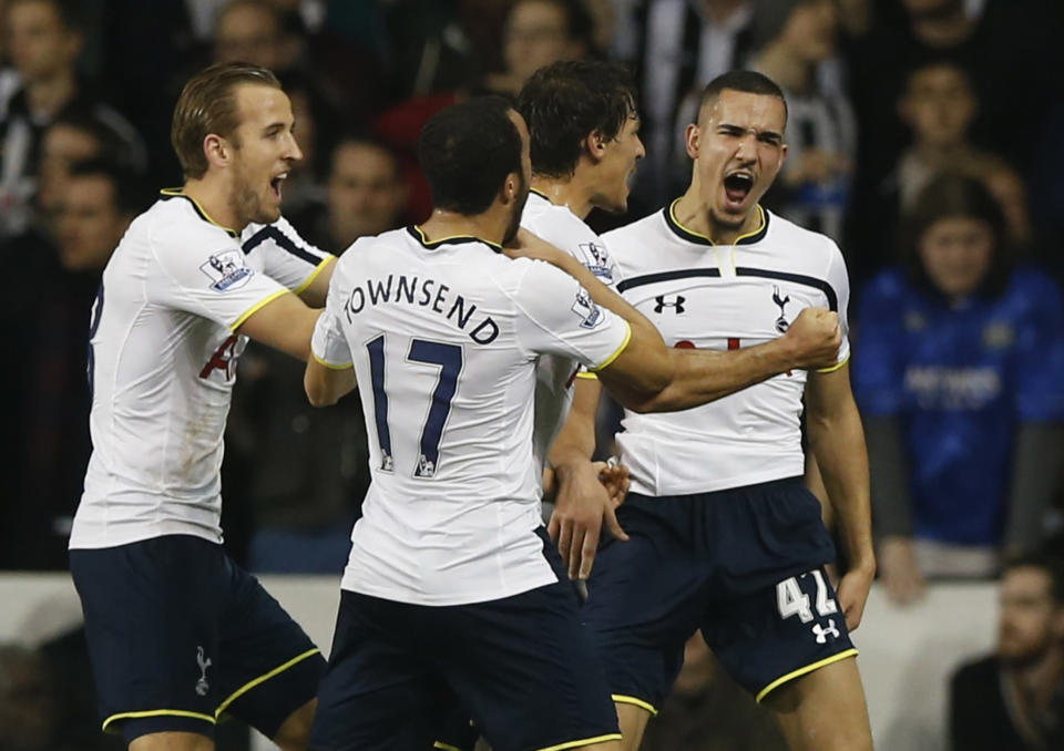 Tottenham's Nabil Bentaleb, right, celebrates after scoring the opening goal during their English League Cup soccer quarterfinal match between Tottenham Hotspur and Newcastle United at White Hart Lane stadium in London Wednesday, Dec. 17, 2014. (AP Photo/Alastair Grant)