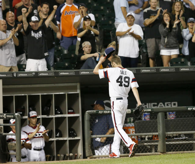 Chicago White Sox starting pitcher Chris Sale tips his cap to applauding fans as he leaves a baseball game during the ninth inning against the Houston Astros, Wednesday, Aug. 28, 2013, in Chicago. (AP Photo/Charles Rex Arbogast)