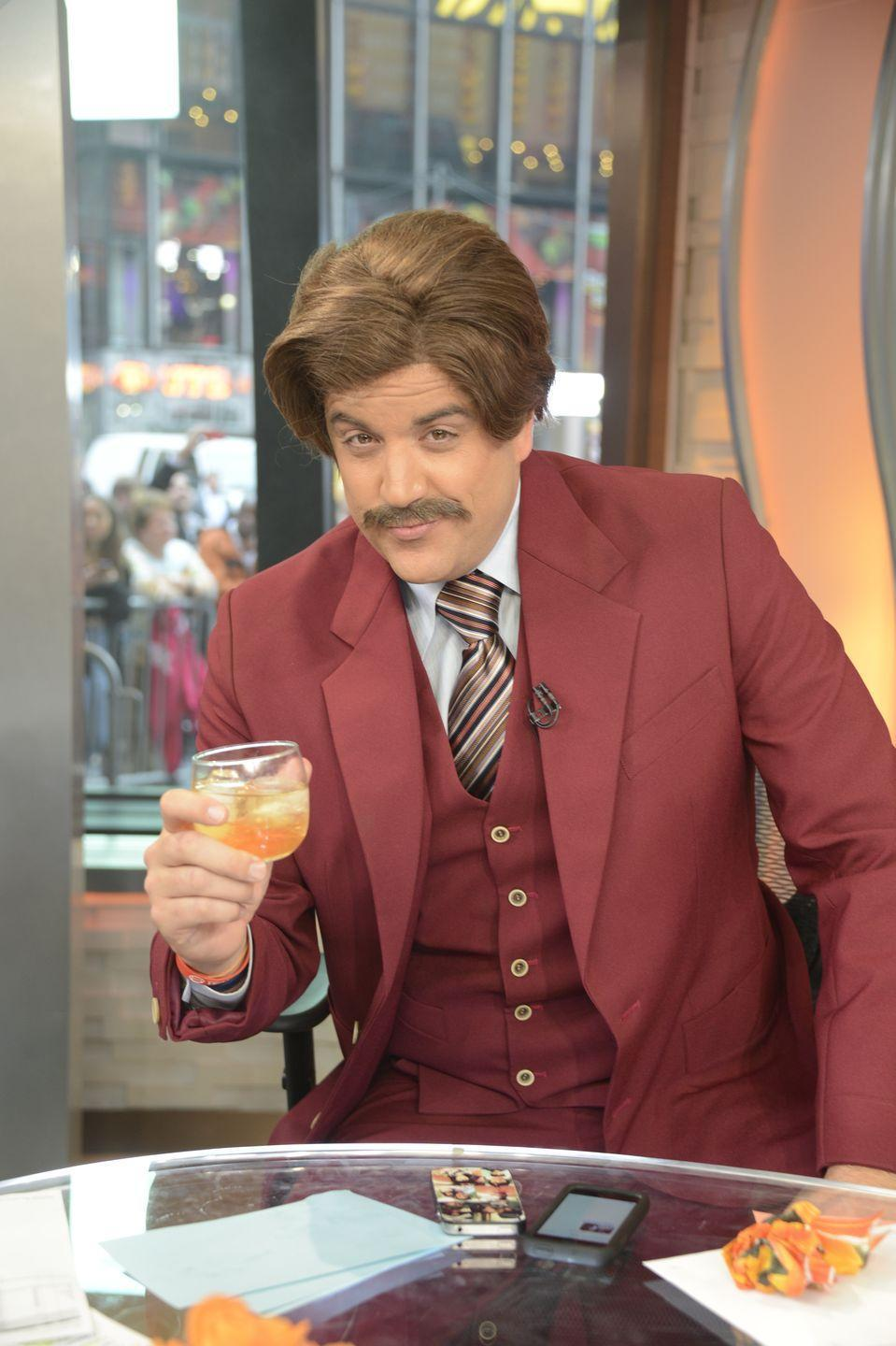 """<p>Stay classy and pour yourself a glass of scotch to elevate this classic <em>Anchorman</em> costume to the next level. To recreate, simply pick out your finest burgundy suit, groom your 'stache, and give your hair some volume. </p><p><a class=""""link rapid-noclick-resp"""" href=""""https://www.amazon.com/MyPartyShirt-Ron-Burgundy-70s-Mustache/dp/B016CHHL0Q/?tag=syn-yahoo-20&ascsubtag=%5Bartid%7C10055.g.28089320%5Bsrc%7Cyahoo-us"""" rel=""""nofollow noopener"""" target=""""_blank"""" data-ylk=""""slk:SHOP WIGS"""">SHOP WIGS</a></p>"""