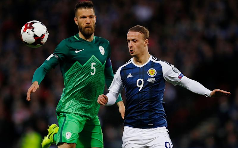 Britain Football Soccer - Scotland v Slovenia - 2018 World Cup Qualifying European Zone - Group F - Hampden Park, Glasgow, Scotland - 26/3/17 Slovenia's Bostjan Cesar in action with Scotland's Leigh Griffiths Action Images via Reuters / Jason Cairnduff - Credit: REUTERS