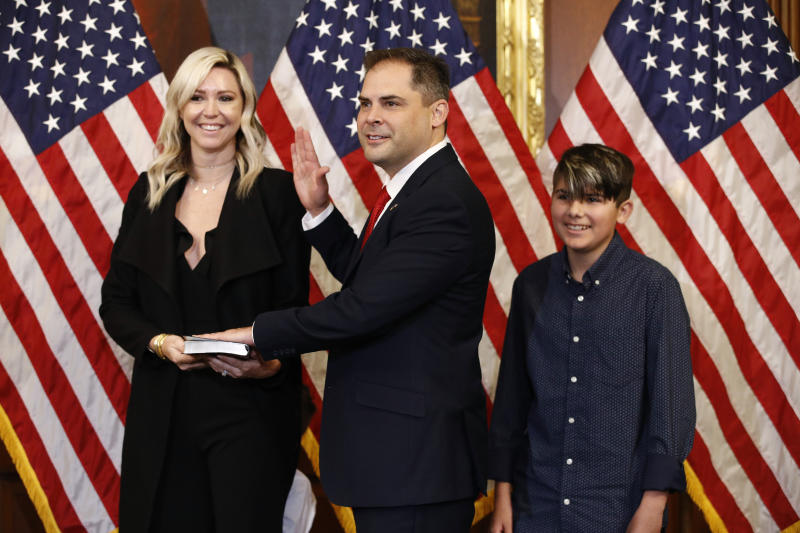 FILE - In this May 19, 2020, file photo Rep. Mike Garcia, R-Calif., center, joined by his wife Rebecca and son Preston, participates in a ceremonial swearing-in with House Speaker Nancy Pelosi of Calif., on Capitol Hill in Washington. Republicans are celebrating their recent capture of a Democratic-held House seat north of Los Angeles. They say it shows they can win suburban districts whose centrist voters fled the GOP two years ago, costing it the chamber's majority. (AP Photo/Patrick Semansky, File)