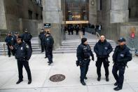 NYPD officers and NY court security police wait for the arrival of film producer Harvey Weinstein at New York Criminal Court for his sexual assault trial in the Manhattan borough of New York City