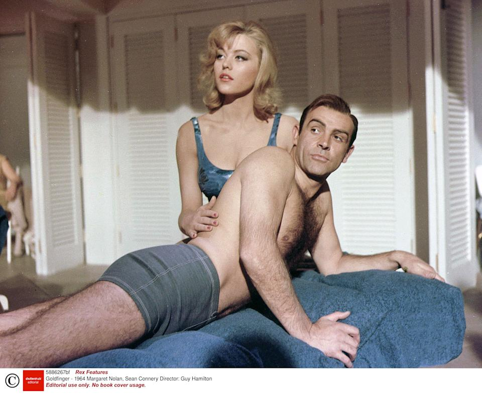 <p>Sean Connery with Margaret Nolan in 'Goldfinger'</p>Rex Features