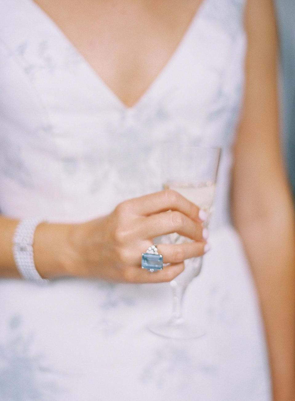 My Grandmother's aquamarine ring that is now my mom's. She let me wear it as my something blue.