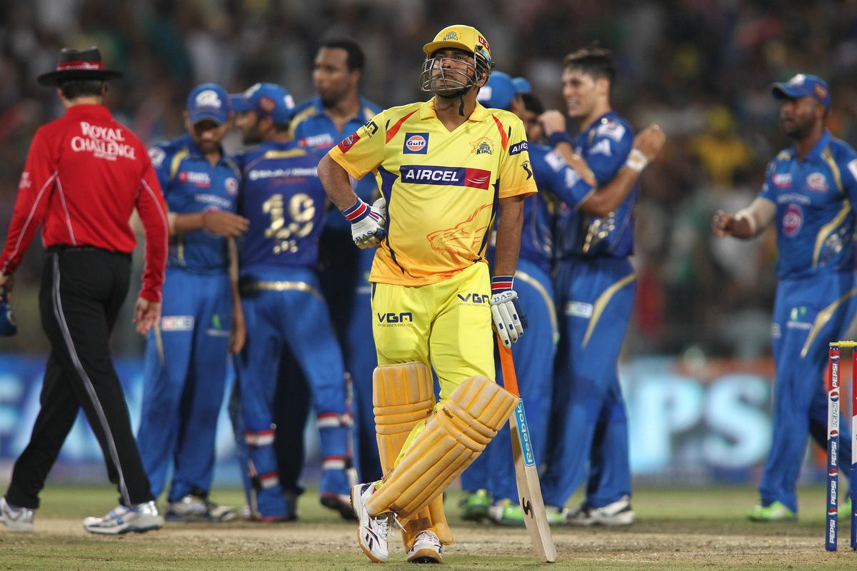 Chennai Super Kings captain MS Dhoni looks on as another wicket falls during the Final of the Pepsi Indian Premier League between The Chennai Superkings and the Mumbai Indians held at the Eden Gardens Stadium in Kolkata on the 26th May 2013..Photo by Saikat Das-IPL-SPORTZPICS       ..Use of this image is subject to the terms and conditions as outlined by the BCCI. These terms can be found by following this link:..https://ec.yimg.com/ec?url=http%3a%2f%2fwww.sportzpics.co.za%2fimage%2fI0000SoRagM2cIEc&t=1498659689&sig=9YmXM.E0bqVk4uuupJOC8Q--~C