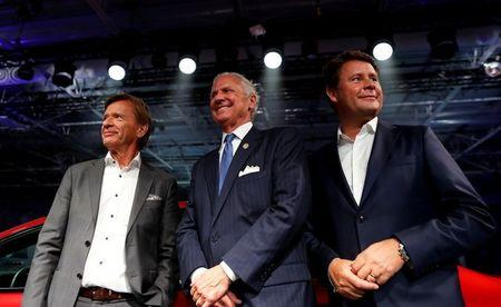 Volvo Cars President & CEO Håkan Samuelsson (L) and Senior Vice President Americas, Anders Gustafsson (R) pose for photos with South Carolina Governor Henry McMaster during the inauguration of Volvo Cars first U.S. production plant in Ridgeville, South Carolina, U.S., June 20, 2018.  REUTERS/Randall Hill