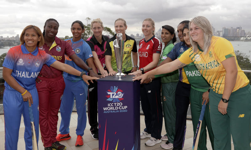 The captains of the 10 countries participating in the Women's T20 World Cup pose fore a photo with the trophy in Sydney, Monday, Feb. 17, 2020. The tournament begins Friday, Feb. 21. From left to right are, Sornnarin Tippoch of Thailand, Stafanie Taylor of West Indies, Harmanpreet Kaur of India, Sophie Devine, of New Zealand, Meg Lanning of Australia, Heather Knight of England, Salma Khatun of Bangladesh. Chamari Atapattu of Sri Lanka, Bismah Maroof of Pakistan and Dane van Niekerk of South Africa. (AP Photo/Rick Rycroft)