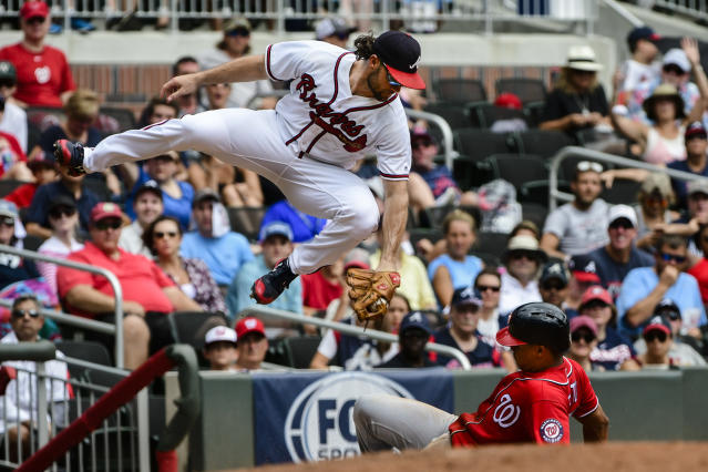 Washington Nationals' Juan Soto steals third base as Atlanta Braves third baseman Charlie Culberson tries to make a tag after going high for the ball during the fourth inning of a baseball game Saturday, Sept. 15, 2018, in Atlanta. (AP Photo/John Amis)