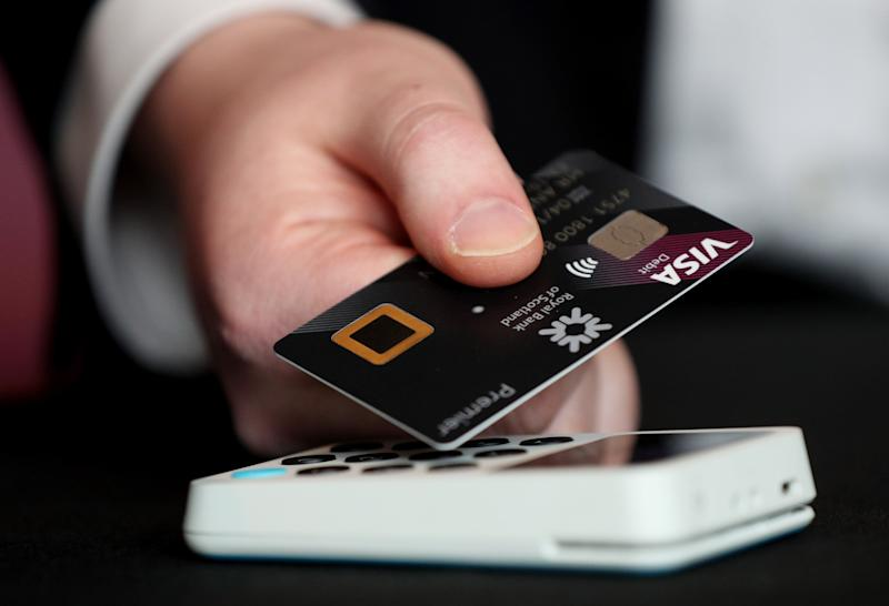 A 'biometric fingerprint debit card' being demonstrated during its launch at NatWest, 280 Bishopsgate, London. Photo: Jonathan Brady/PA Wire/PA Images