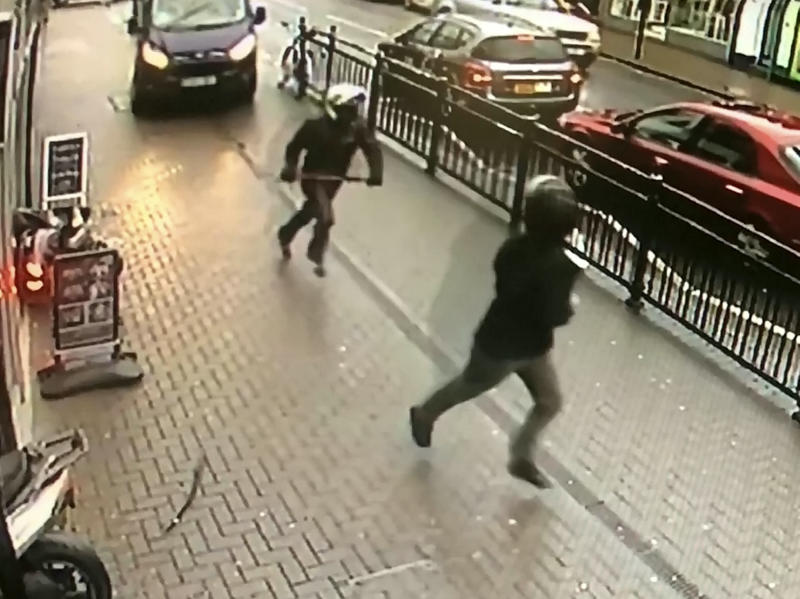 A van driver blocks the pavement to stop the gang from driving away. (SWNS)