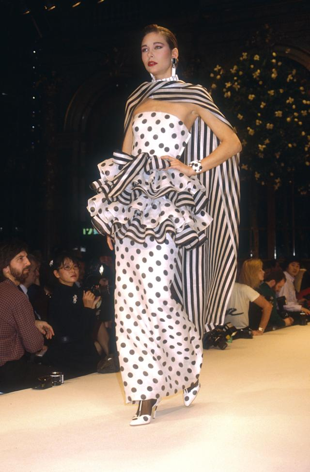 A fashion model wears a strapless, black-and-white polk dot haute couture evening gown from the French designer's spring/summer 1988 show in Paris.