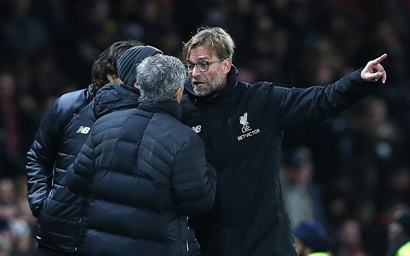 Jurgen Klopp raises a point of order with Jose Mourinho - EPA