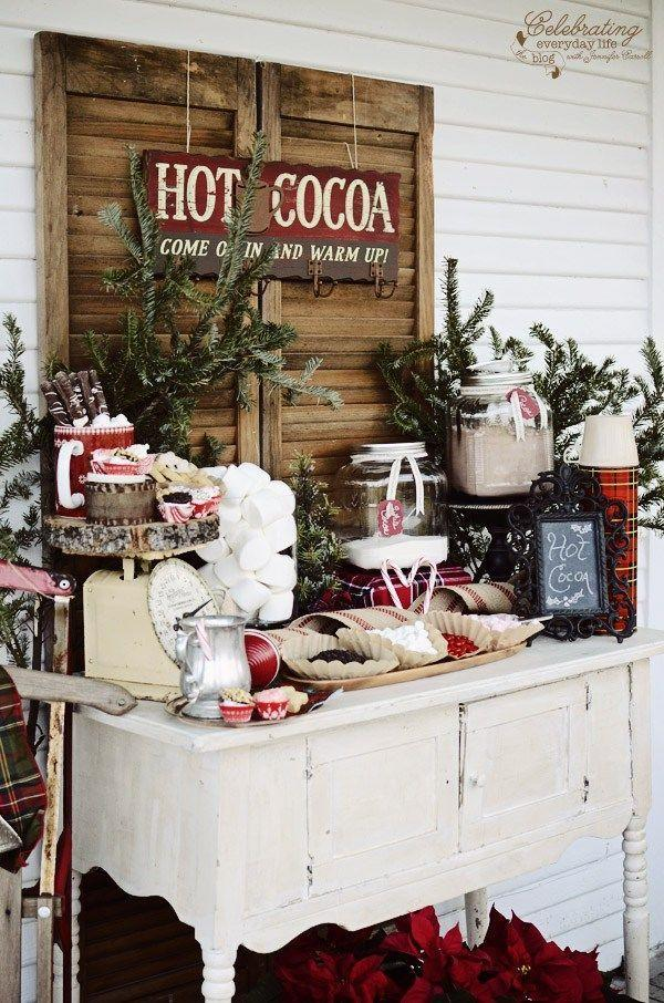"""<p>This fun idea from <a href=""""http://celebratingeverydaylife.com/front-porch-hot-cocoa-bar/"""" rel=""""nofollow noopener"""" target=""""_blank"""" data-ylk=""""slk:Celebrating Everyday Life"""" class=""""link rapid-noclick-resp"""">Celebrating Everyday Life</a> is perfect for entertaining a crowd, but it's also just as sweet for treating a small group. Arrange everything you need to make a mug of <a href=""""https://www.countryliving.com/food-drinks/g2776/hot-chocolate-recipes/"""" rel=""""nofollow noopener"""" target=""""_blank"""" data-ylk=""""slk:hot chocolate"""" class=""""link rapid-noclick-resp"""">hot chocolate</a>, plus fun add-ons like peppermint sticks, sprinkles, Christmas candy, special sauces, and more.</p><p><a class=""""link rapid-noclick-resp"""" href=""""https://www.amazon.com/Ghirardelli-Chocolate-Premium-0-85-Ounce-Packets/dp/B001G0MG46/ref=sr_1_10?dchild=1&keywords=hot+cocoa&qid=1632338796&s=grocery&sr=1-10&tag=syn-yahoo-20&ascsubtag=%5Bartid%7C10050.g.25411840%5Bsrc%7Cyahoo-us"""" rel=""""nofollow noopener"""" target=""""_blank"""" data-ylk=""""slk:SHOP HOT COCOA"""">SHOP HOT COCOA</a></p>"""