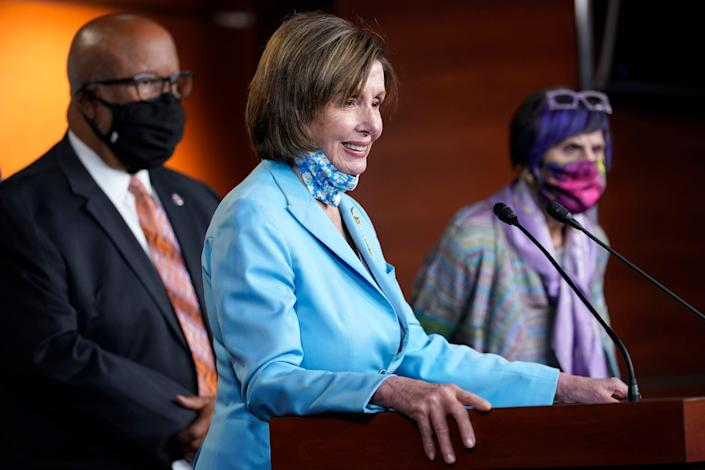 House Speaker Nancy Pelosi of Calif., center, flanked by Rep. Benny Thompson, D-Miss., left, and Rep. Rosa DeLauro, D-Conn., right, talks to reporters on Capitol Hill in Washington, Wednesday, May 19, 2021, about legislation to create an independent, bipartisan commission to investigate the Jan. 6 attack on the United States Capitol Complex.