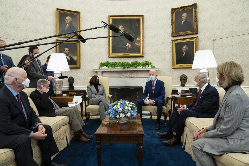 FILE - In this Feb. 11, 2021, file photo President Joe Biden speaks during a meeting with lawmakers on investments in infrastructure, in the Oval Office of the White House in Washington. From left, Sen. Ben Cardin, D-Md., Sen. Jim Inhofe, R-Okla., Vice President Kamala Harris, Biden, Sen. Tom Carper, D-Del., and Sen. Shelley Moore Capito, R-W.Va. Looking beyond the $1.9 trillion COVID relief bill, Biden and lawmakers are laying the groundwork for another of his top legislative priorities — a long-sought boost to the nation's roads, bridges and other infrastructure that could meet GOP resistance to a hefty price tag. (AP Photo/Evan Vucci, File)