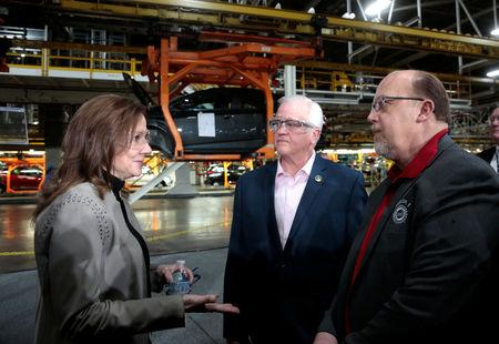 General Motors Chief Executive Officer Mary Barra talks with United Auto Workers union Vice President Terry Dittes and UAW Region 1 Director Frank Stuglin at the GM Orion Assembly Plant in Lake Orion, Michigan, U.S. March 22, 2019.  REUTERS/Rebecca Cook