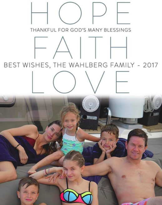 """Stick with what you know! The actor, who rose to fame as a Calvin Klein undies model, posed shirtless on his family card, which appeared to be snapped by a pool or on a yacht. Mark and his fam (wife Rhea Durham and their four kiddos: Ella, Brendan, Grace, and Michael) sent out """"hope,"""" """"faith,"""" and """"love"""" this holiday season. And abs. Don't forget the abs. (Photo: Mark Wahlberg via Instagram)"""