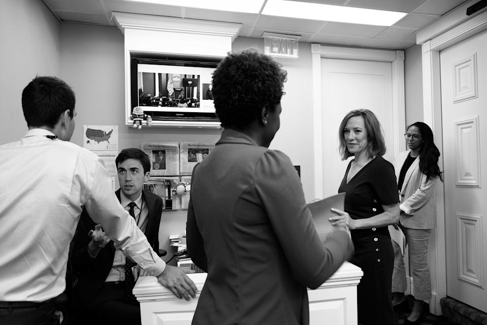 Office Life With colleagues including press assistant Michael Kikukawa (second from left) and Amanda Finney, the chief of staff for the press office and special assistant to the press secretary (far right).