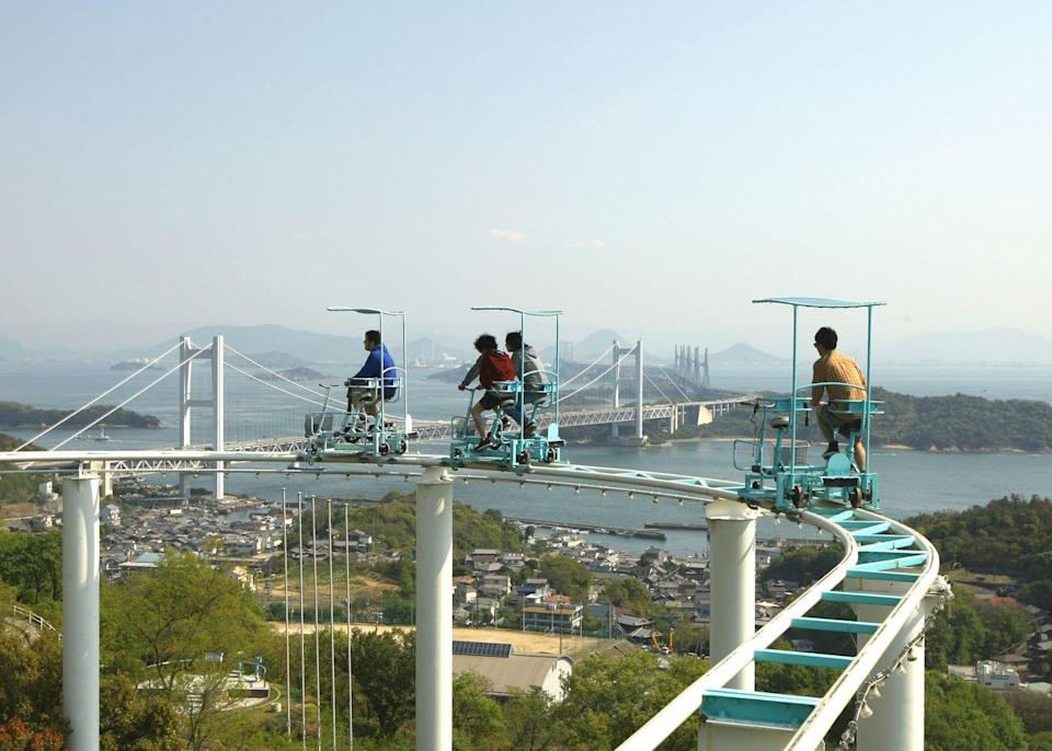 """<p>Theme park operators are constantly coming up with new ways to launch and power their roller coaster cars, but this coaster goes low-tech — it's pedal-powered. Riders travel at their own pace while four stories off the ground, and they can even <a href=""""https://www.atlasobscura.com/places/washuzan-highland"""" rel=""""nofollow noopener"""" target=""""_blank"""" data-ylk=""""slk:stop and take pictures"""" class=""""link rapid-noclick-resp"""">stop and take pictures</a> if they feel like it. </p>"""