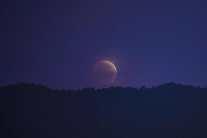 A lunar eclipse is seen on May 26, 2021 in Mexico City.  Mexico / Credit: Manuel Velasquez/Anadolu Agency via Getty Images