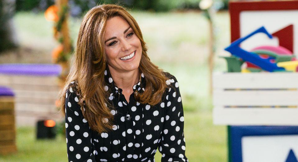 The Duchess of Cambridge wore an Emilia Wickstead polka dot dress in July while discussing her latest venture Tiny Happy People. (Getty Images)