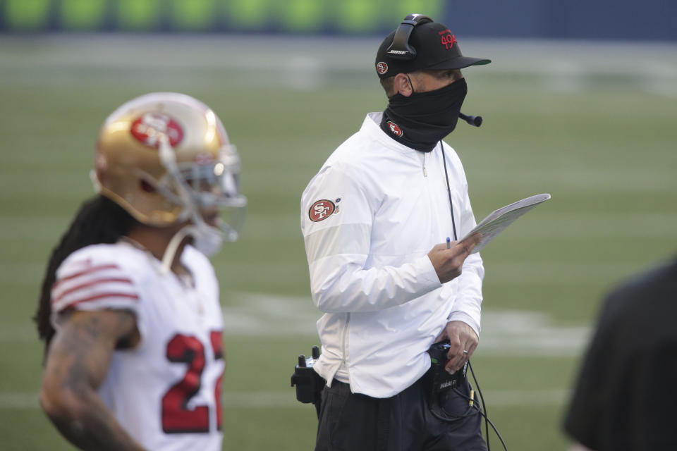 San Francisco 49ers head coach Kyle Shanahan stands on the sideline during the second half of an NFL game against the Seattle Seahawks.