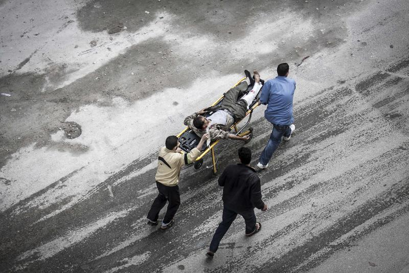 In this Tuesday, Oct. 23, 2012 photo, Syrian residents wheel a man injured from an artillery shell that landed near a bakery, to a hospital for treatment in Aleppo, Syria. Several were killed and a dozen were injured after the artillery shell that landed near a bakery in Aleppo on Tuesday, Oct. 23, 2012. (AP Photo/Narciso Contreras).