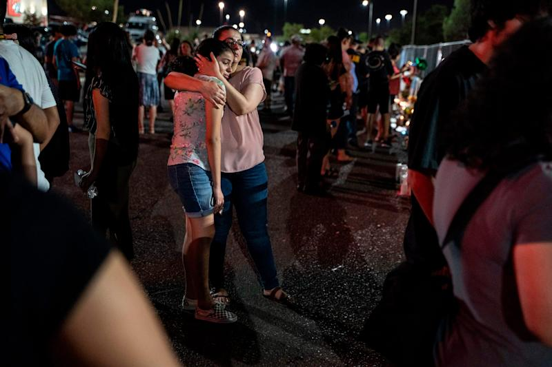 Locals of El Paso visit the memorial for shooting victims at the Cielo Vista Mall Walmart in El Paso, Texas on August 8, 2019.