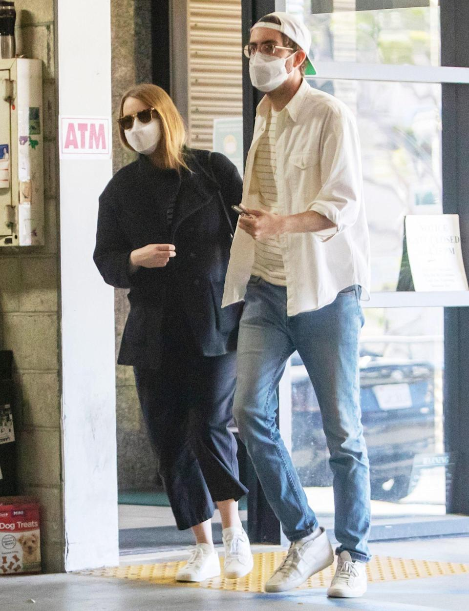 <p>Mom-to-be Emma Stone is seen heading out with husband Dave McCary in L.A. on Friday.</p>
