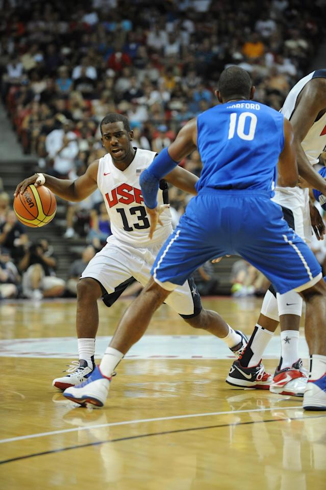 LAS VEGAS, NV - JULY 12: Chris Paul #13 of the US Men's Senior National Team drives against Al Horford #10 of the Dominican Republic during an exhibition game at the Thomas and Mack Center on July 12, 2012 in Las Vegas, Nevada. NOTE TO USER: User expressly acknowledges and agrees that, by downloading and/or using this Photograph, user is consenting to the terms and conditions of the Getty Images License Agreement. Mandatory Copyright Notice: Copyright 2012 NBAE (Photo by Noah Graham/NBAE via Getty Images)