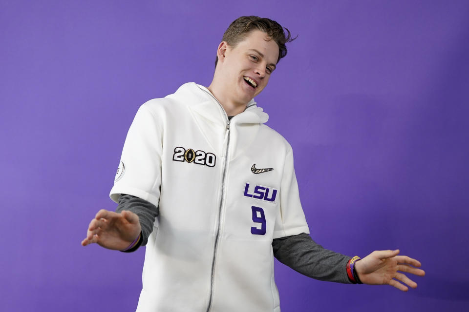 LSU quarterback Joe Burrow poses during media day for NCAA College Football Playoff national championship game Saturday, Jan. 11, 2020, in New Orleans. Clemson is scheduled to play LSU on Monday. (AP Photo/David J. Phillip).