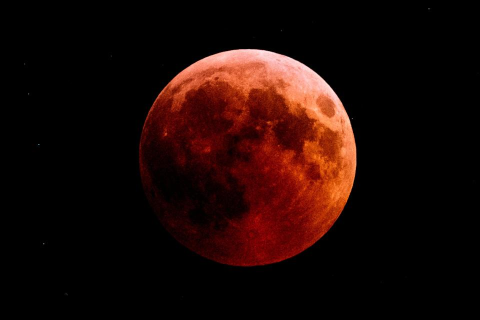 """The full moon turned to a """"blood moon"""" during an eclipse seen from the town of Kazanlak, Bulgaria, on July 27, 2018."""