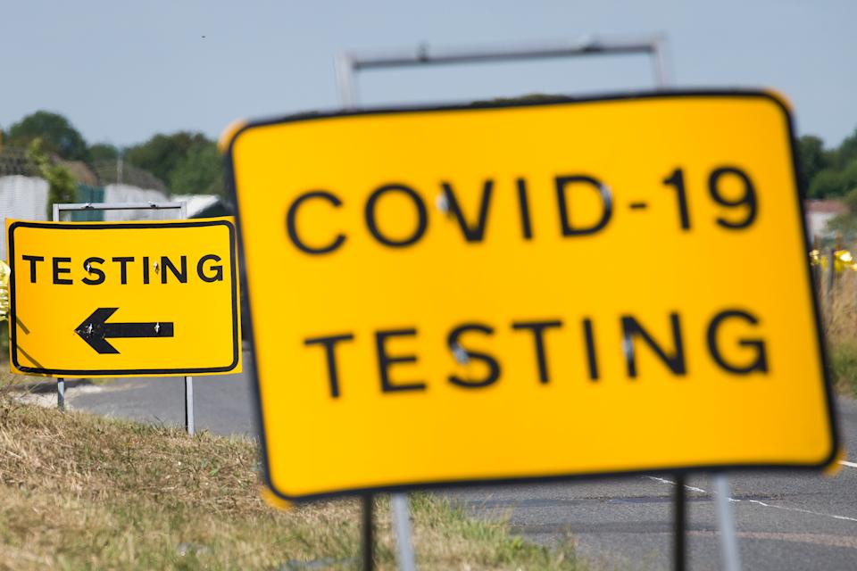 """MANSTON, ENGLAND - AUGUST 04: A traffic sign directs people towards the temporary testing centre on the site at Manston Airport on August 04, 2020 in Manston, England. A group of Britain's leading virus experts have written to the government, expressing their frustration at the mistakes being made in the country's response to the COVID-19 pandemic. In the letter, signed by nearly 70 clinical virologists, they state that """"Our skills have been underused and underrepresented (albeit to differing extents within the devolved nations of the UK), resulting in lost opportunities to establish a coordinated robust and durable testing framework for Sars-CoV-2."""" (Photo by Leon Neal/Getty Images)"""