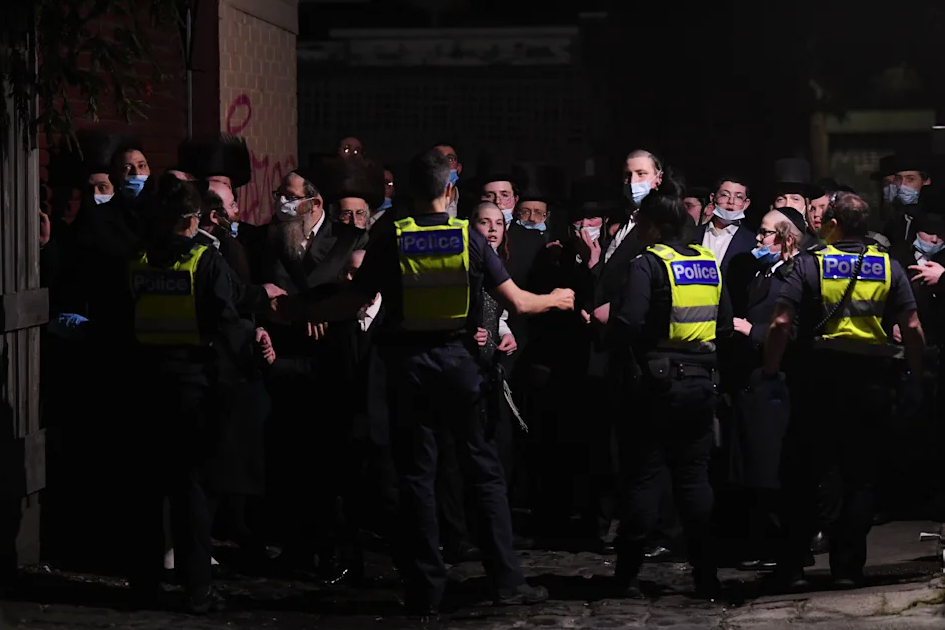 Victoria Police field worshippers at Ripponlea synagogue in Melbourne on Tuesday night after an illegal gathering.