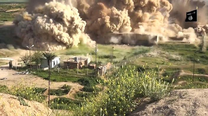 Image grab taken from a video made available by Jihadist media outlet Welayat Nineveh on April 11, 2015, allegedly shows smoke billowing from an ancient site after it was wired with explosives by Islamic State militant group in northern Iraq (AFP Photo/)