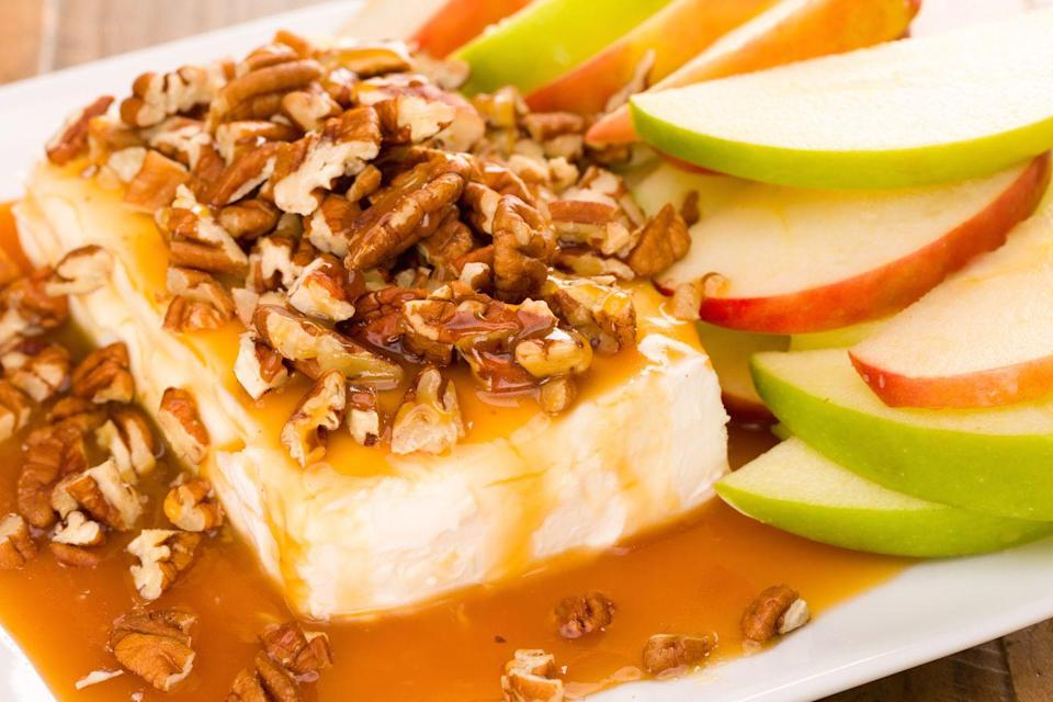 """<p>If the struggle of eating caramel apples is real for you, it's time to try this dip.</p><p>Get the recipe from <a href=""""https://www.delish.com/cooking/recipe-ideas/recipes/a43820/caramel-apple-cheesecake-dip-recipe/"""" rel=""""nofollow noopener"""" target=""""_blank"""" data-ylk=""""slk:Delish"""" class=""""link rapid-noclick-resp"""">Delish</a>.</p>"""