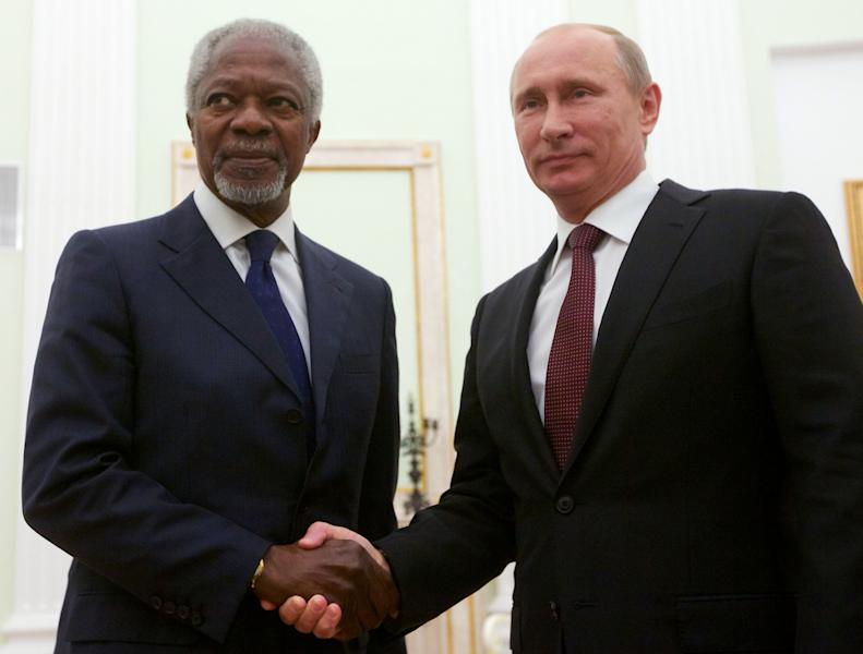 Russian President Vladimir Putin, right, shakes hands with United Nations special envoy Kofi Annan in Moscow, Russia, Tuesday, July 17, 2012. Annan discussed the Syria crisis with Lavrov on Monday, and is scheduled to meet with President Putin on Tuesday. The UN and Arab League envoy to the Syrian crisis has begun his meeting with the Russian president by saying that Syria is at a crossroads, as violence escalates. (AP Photo/Alexander Zemlianichenko)