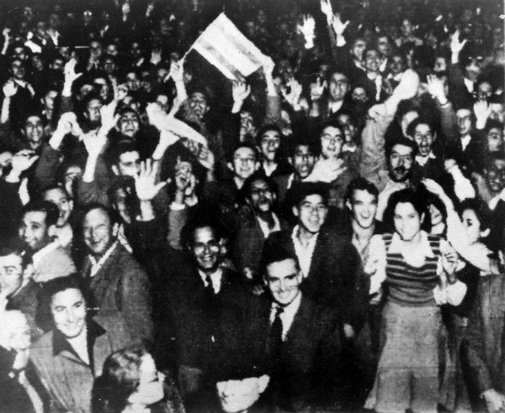 FILE - In this Nov. 29, 1947 file photo, Jewish residents wave jubilantly in the streets in Tel Aviv, Israel, on after the United Nations voted to partition Palestine into separate Jewish and Arab states. (AP Photo, File)