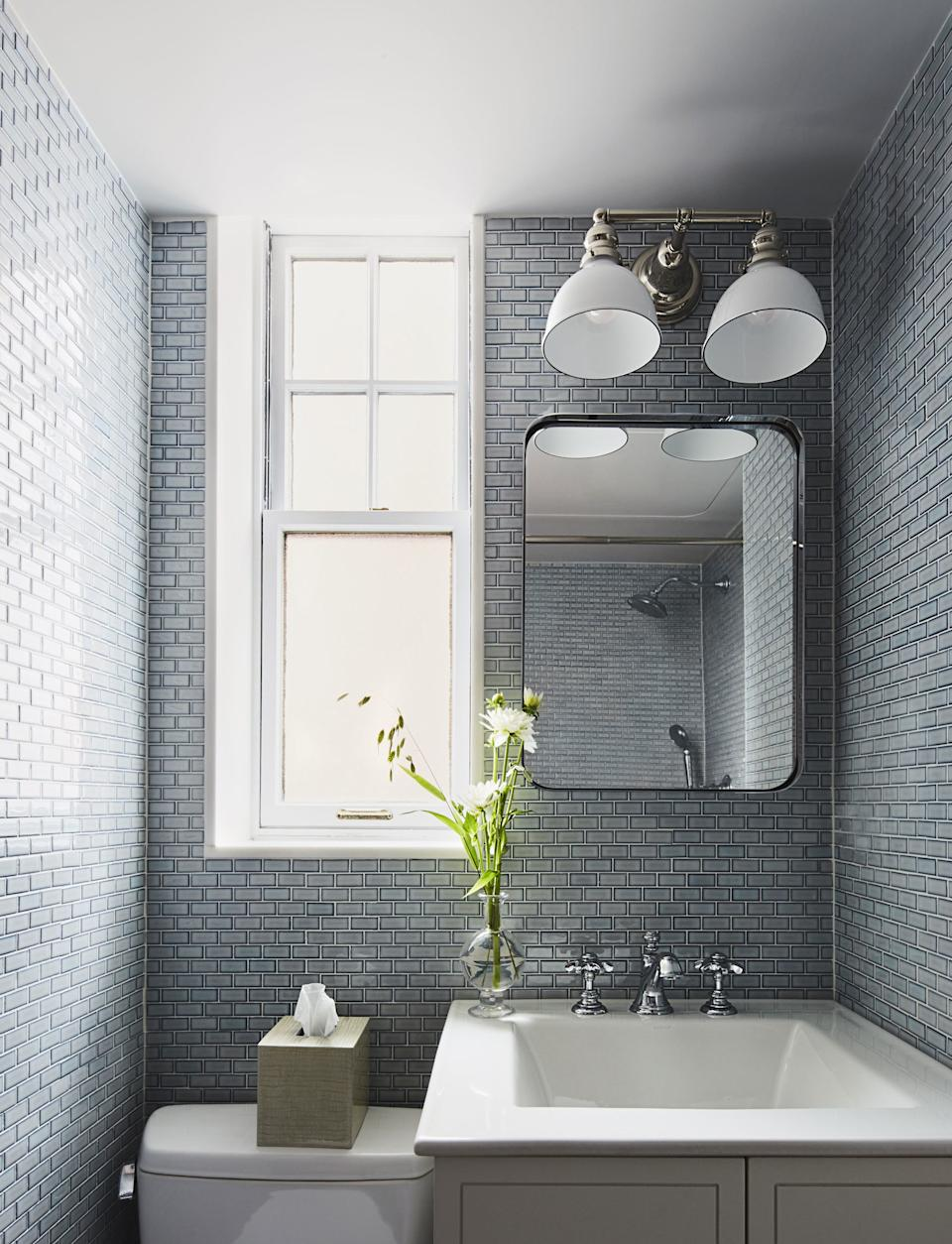 McGrath II used floor tile to cover the walls of this small bathroom.